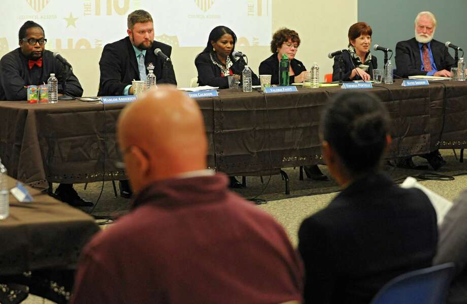 From left, Mayoral candidates Marlon Anderson (I-D), Jesse Calhoun (R), Rev. Valerie Faust (I-D), Theresa Portelli (Green), Kathy Sheehan (D), and Joseph Sullivan (C) participate in a debate at the Albany Public Library on Monday, Oct. 21, 2013 in Albany, N.Y.  (Lori Van Buren / Times Union) Photo: Lori Van Buren / 00024237A