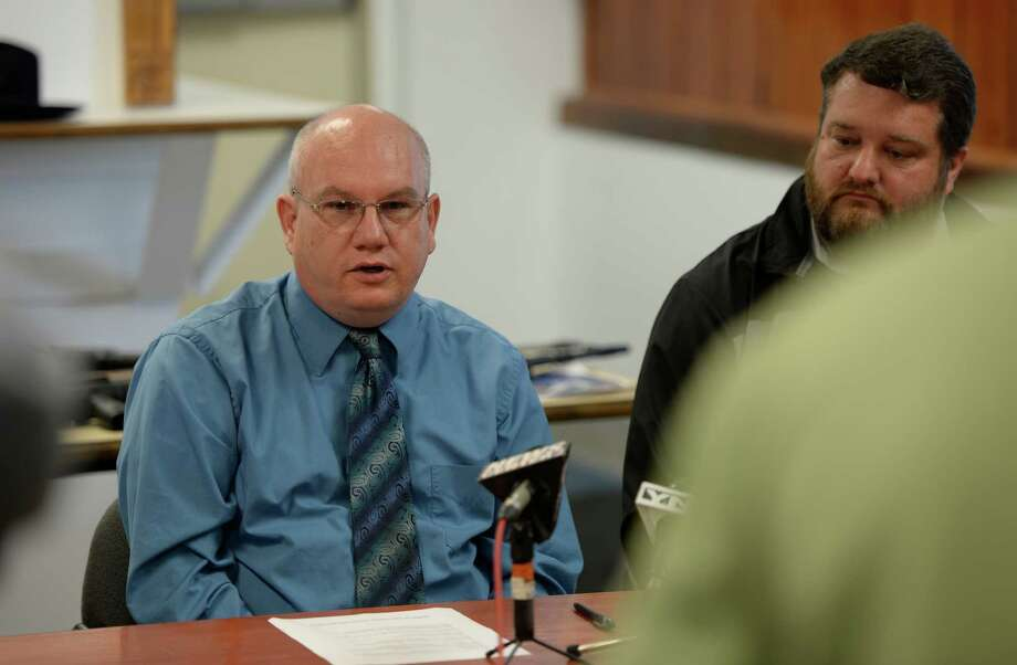 Coeymans Police Chief Gregory Darlington, left, gives details of drug arrests during a press briefing Thursday morning Oct. 24, 2013, in Coeymans, N.Y.  Joining Darlington is Town Supervisor Stephen Flach, right.    (Skip Dickstein/Times Union Photo: SKIP DICKSTEIN / 00024374A
