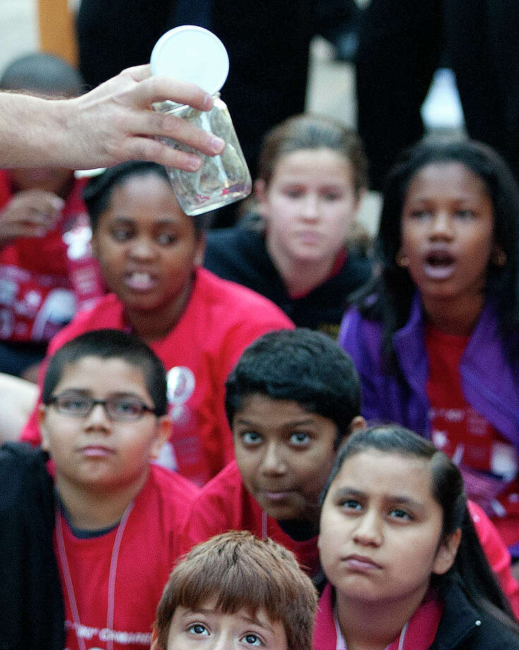 Magnolia Police Department Sgt. Eric Silliman with the K-9 unit, shows students a container of marijuana during an anti-drug demonstration. Photo: Johnny Hanson, Houston Chronicle / Houston Chronicle