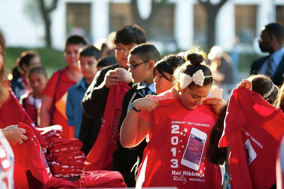 "More than 500 middle school students from the greater Houston area are handed red T-shirts as they attended the 20th Annual Enrique ""Kiki"" Camarena Red Ribbon Rally promoting a drug free lifestyle outside City Hall. Photo: Johnny Hanson, Houston Chronicle / Houston Chronicle"