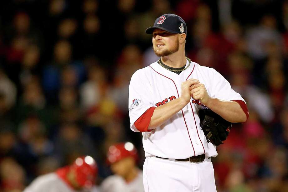 BOSTON, MA - OCTOBER 23:  Jon Lester #31 of the Boston Red Sox looks on against the St. Louis Cardinals during Game One of the 2013 World Series at Fenway Park on October 23, 2013 in Boston, Massachusetts.  (Photo by Elsa/Getty Images) ORG XMIT: 185688132 Photo: Elsa / 2013 Getty Images