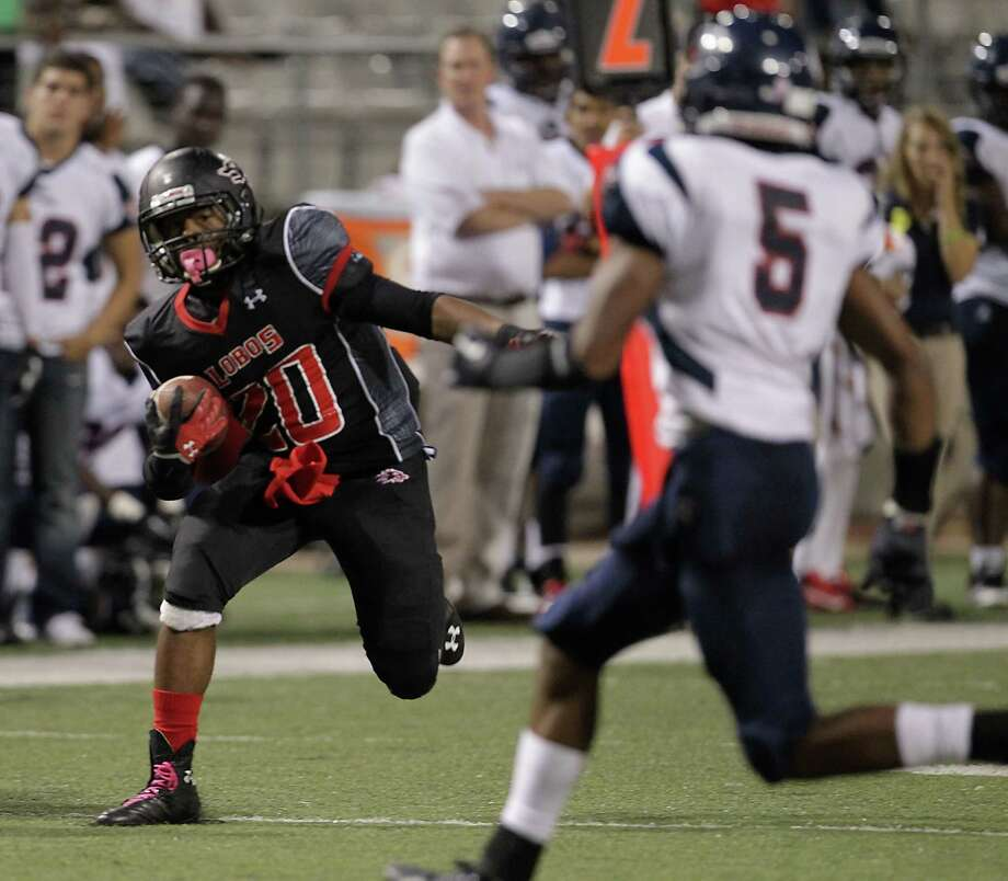 Langham Creek's Christopher Willams left, and Cypress Springs' Jimmy Washington right, during the second quarter of high school football game action at the Berry Center Thursday, Oct. 24, 2013, in Cypress. Photo: James Nielsen, Houston Chronicle / © 2013  Houston Chronicle