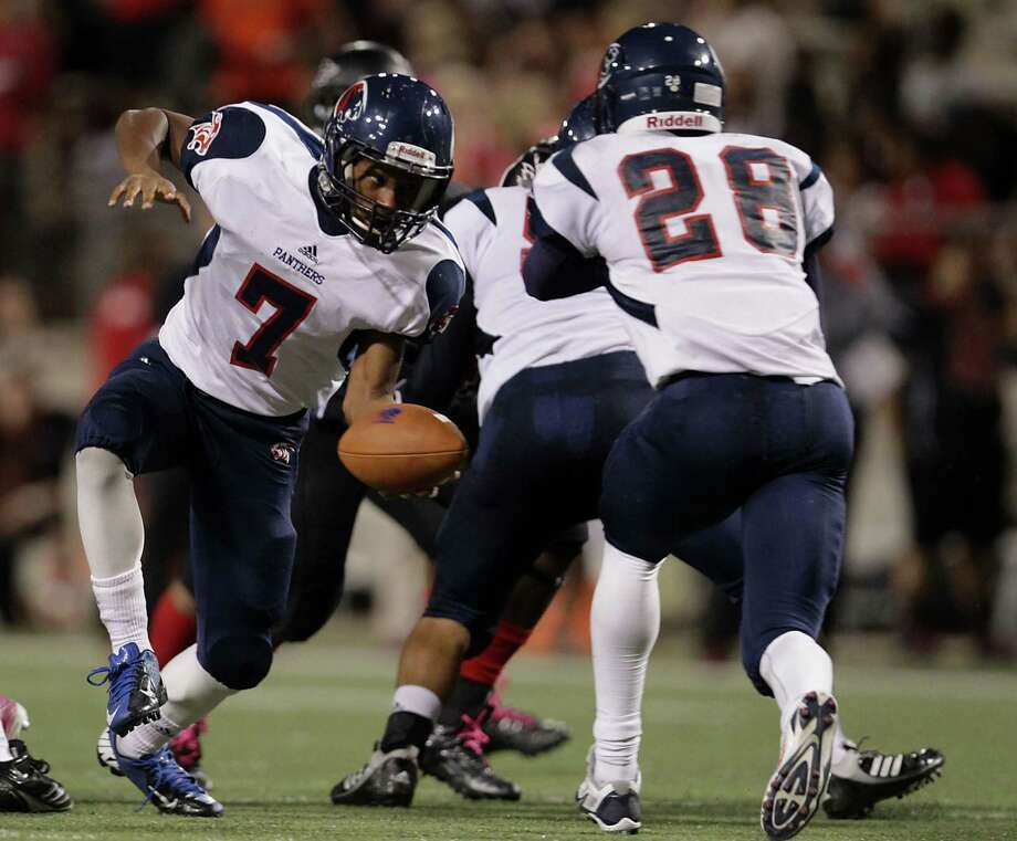 Cypress Springs' Brian Harden left, fakes a handoff during the second quarter of high school football game action against Langham Creek at the Berry Center Thursday, Oct. 24, 2013, in Cypress. Photo: James Nielsen, Houston Chronicle / © 2013  Houston Chronicle