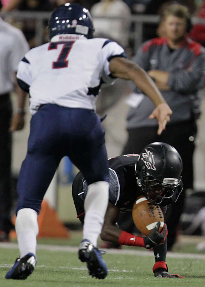 Langham Creek's Jacob Hobbs right, intercepts the ball as  Cypress Springs' Brian Harden prepares to chase during the second quarter of high school football game action at the Berry Center Thursday, Oct. 24, 2013, in Cypress. Photo: James Nielsen, Houston Chronicle / © 2013  Houston Chronicle