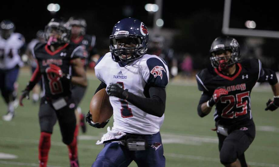 Cypress Springs' Kevin Lovings center, runs the ball for a touchdown against Langham Creek during the second quarter of high school football game action at the Berry Center Thursday, Oct. 24, 2013, in Cypress. Photo: James Nielsen, Houston Chronicle / © 2013  Houston Chronicle