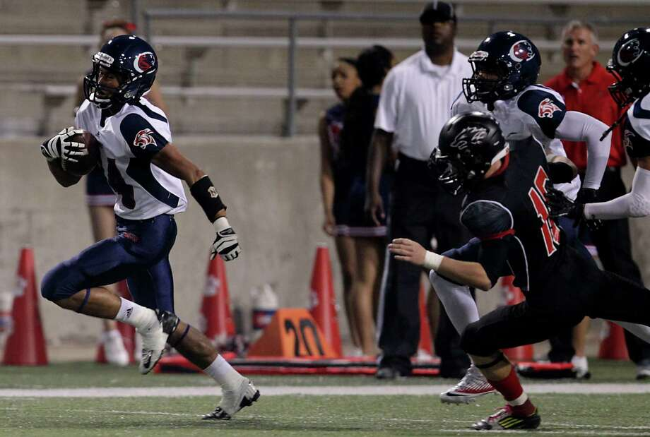 Cypress Springs' Jason Schilling left, returns the kickoff for a touchdown against Langham Creek at the start of the first quarter of high school football game action at the Berry Center Thursday, Oct. 24, 2013, in Cypress. Photo: James Nielsen, Houston Chronicle / © 2013  Houston Chronicle