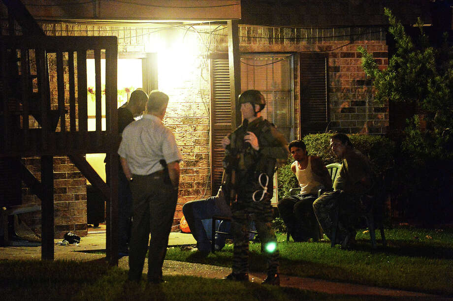 Beaumont Police and SWAT executed a search warrant at approximately 8:55 p.m. Thursday at an apartment complex located at the intersection of McFaddin Avenue and Sixth Street. Lt. Ky Brown said they had been working on the case for about two weeks. Photo taken Oct. 24, 2013. Michael Rivera/The Enterprise