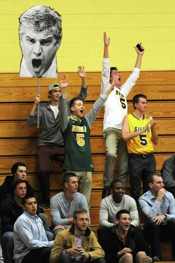 Siena students hold a cut-out of coach Jimmy Patsos as they cheer on their men's basketball team dur