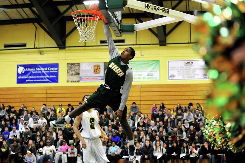 Siena's Maurice White dunks the ball during a basketball scrimmage for Siena Madness on Thursday, Oc