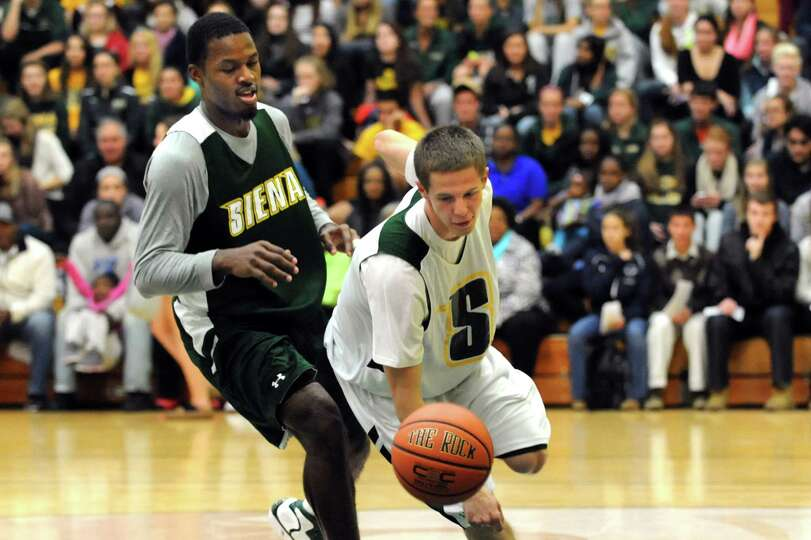 Siena's Mike Wilson, right, controls the ball as Maurice White defendsl during a basketball scrimmag