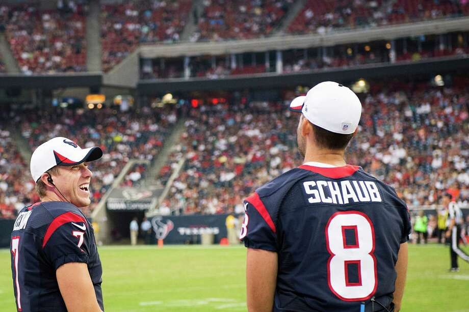 Case Keenum, left, was doing anything but laughing after seeing the Texans lose in his NFL debut, which came only after an injury to starter Matt Schaub. Photo: Smiley N. Pool, Staff / © 2013  Houston Chronicle