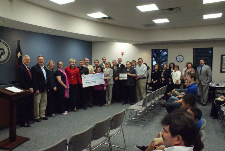 Faculty and staff at the Friendswood Independent School District were honored during the Oct. 14 board meeting. Photo: Courtesy Of Friendswood Independent School District