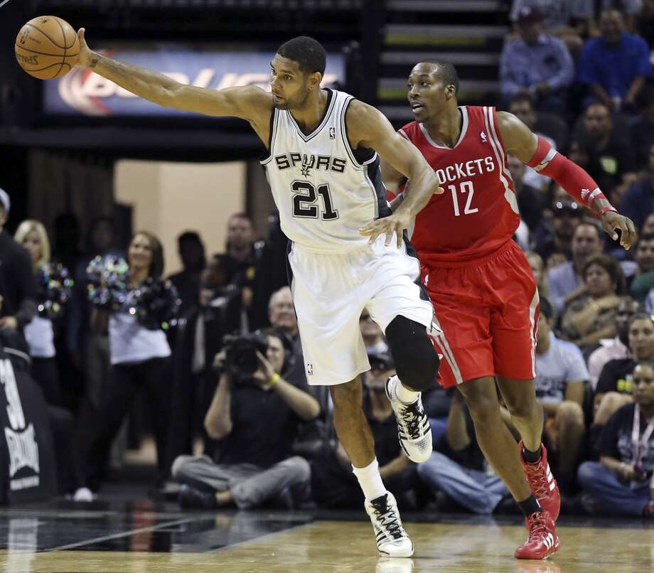 San Antonio Spurs' Tim Duncan grabs a loose ball around Houston Rockets' Dwight Howard during first half action of a preseason game Thursday Oct. 24, 2013 at the AT&T Center. Photo: Edward A. Ornelas, San Antonio Express-News