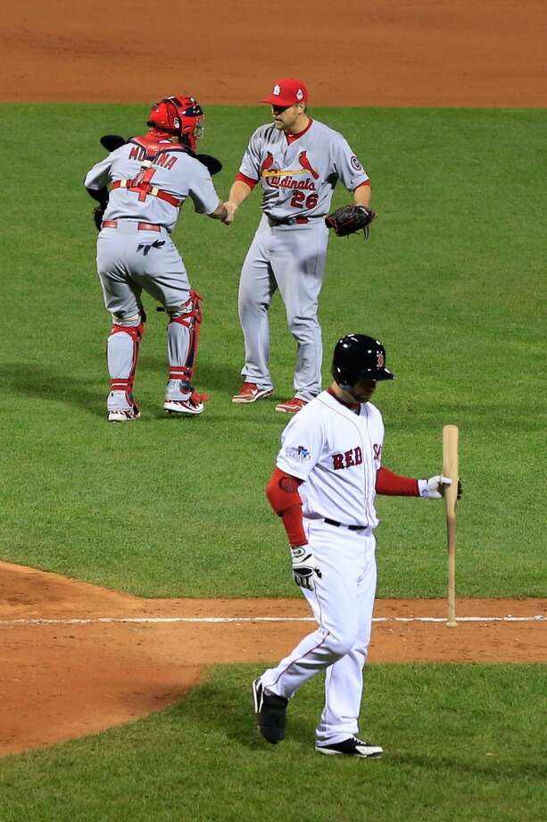 Trevor Rosenthal #26 and Yadier Molina #4 of the Cardinals celebrate. Photo: Jamie Squire, Getty Images