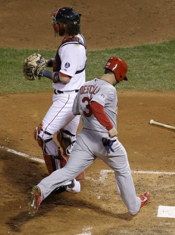 Daniel Descalso scores in front of Red Sox catcher Jarrod Saltalamacchia. Photo: Matt Slocum, Associated Press
