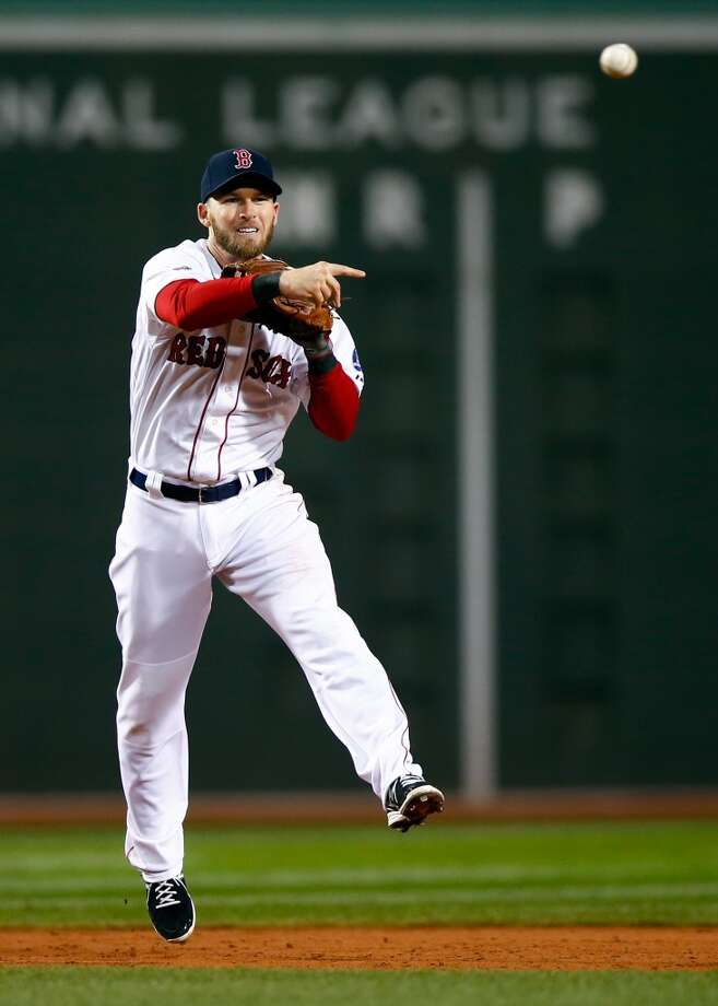 Stephen Drew #7 of the Red Sox throws the ball to first base. Photo: Jared Wickerham, Getty Images