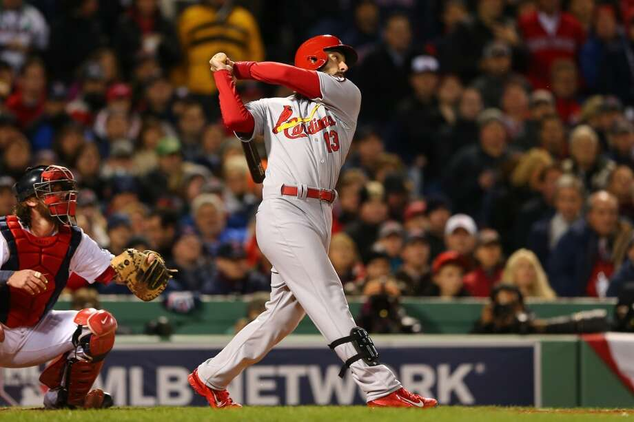 Matt Carpenter #13 of the Cardinals hits against the Red Sox. Photo: Elsa, Getty Images