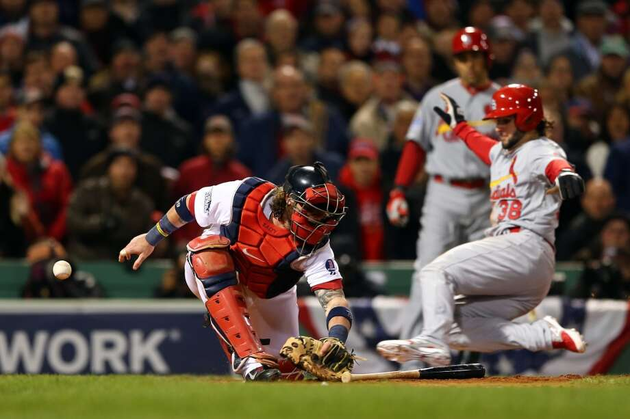Pete Kozma #38 of the Cardinals scores in the seventh inning as Jarrod Saltalamacchia #39 of the Red Sox loses the ball. Photo: Elsa, Getty Images