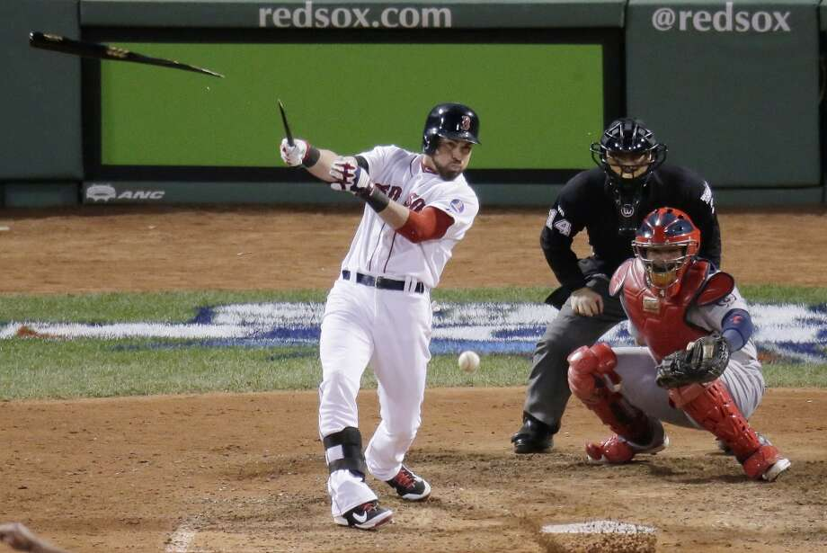 Jacoby Ellsbury breaks his bat as he hits during the eighth inning. Photo: Charlie Riedel, Associated Press