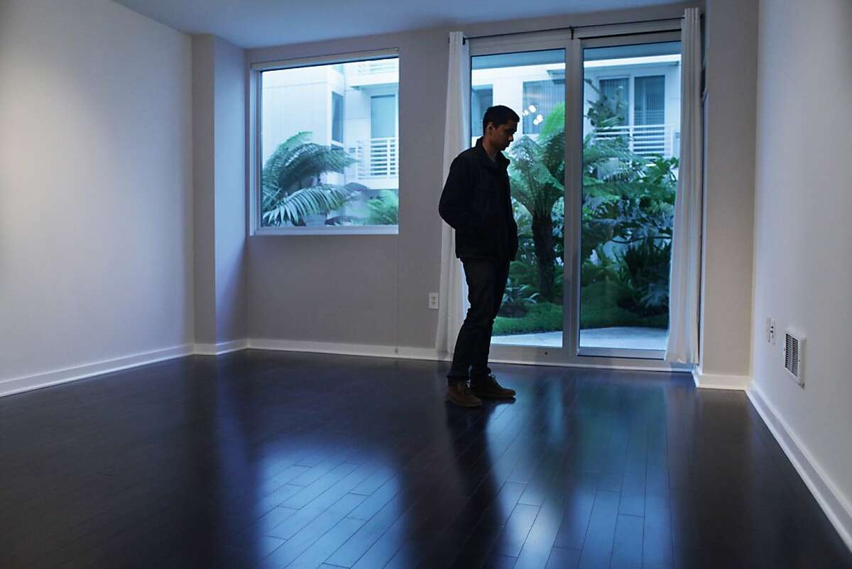Neeloy Roy, looks at a apartment in the AT&T Park area during an open house in San Francisco on October 24th 2013.