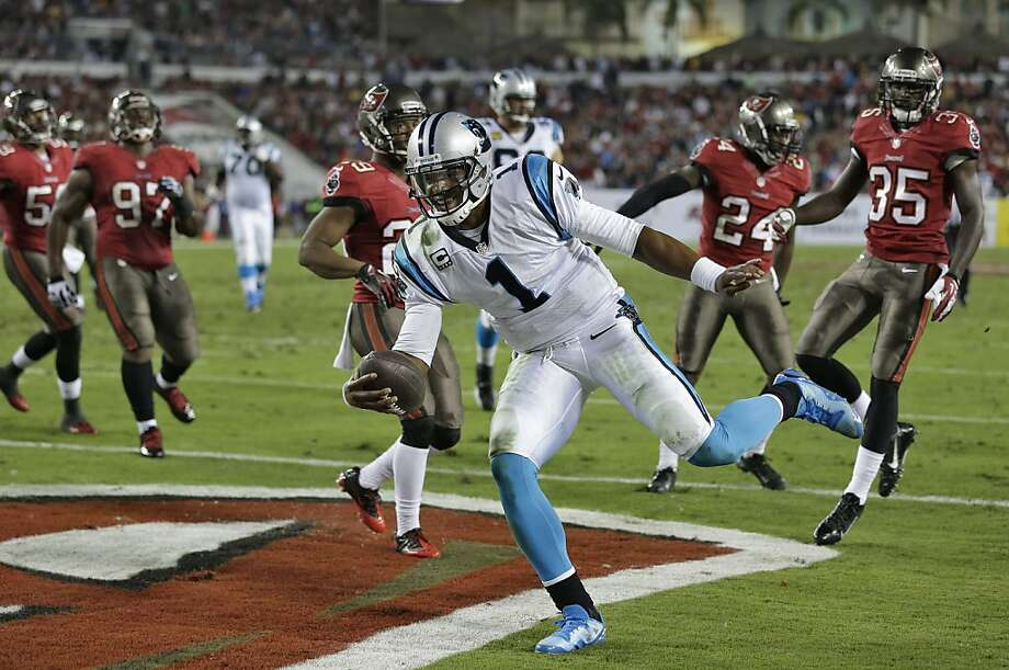 Carolina QB Cam Newton reaches the end zone to complete a 6-yard TD run in the Panthers' victory over the Buccaneers. Photo: Chris O'Meara, Associated Press