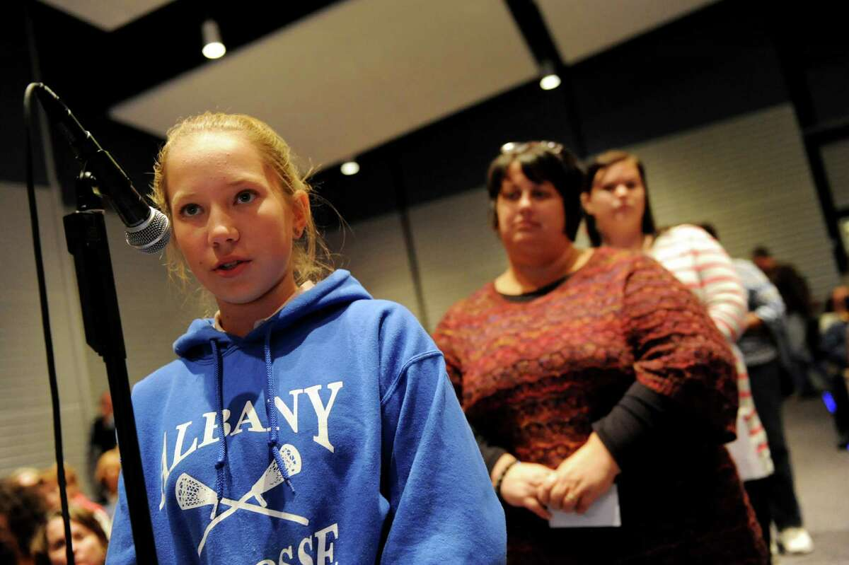 Reeve Churchill, 13, an eighth-grader at Myers Middle School, left, makes her comments during a forum on the Common Core curriculum on Thursday, Oct. 24, 2013, at Myers Middle School in Albany, N.Y. (Cindy Schultz / Times Union)