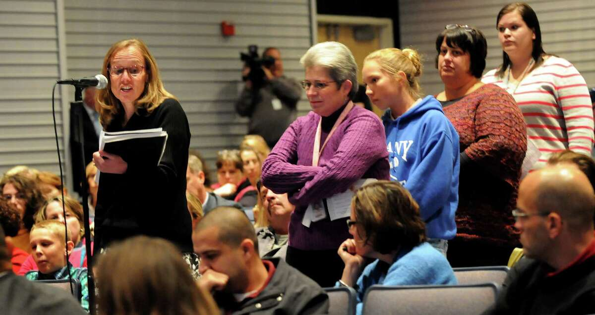Kristin Bonds, an earth science teacher at Schenectady High, left, makes her comments during a forum on the Common Core curriculum on Thursday, Oct. 24, 2013, at Myers Middle School in Albany, N.Y. (Cindy Schultz / Times Union)
