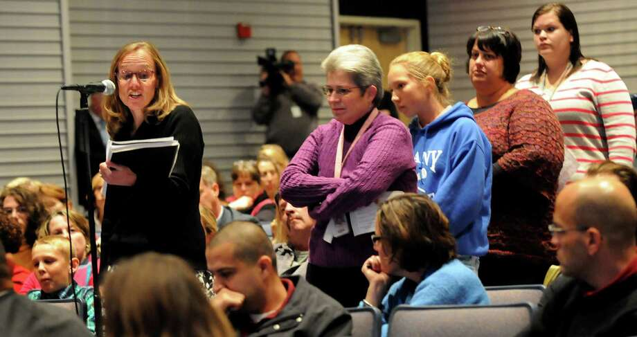 Kristin Bonds, an earth science teacher at Schenectady High, left, makes her comments during a forum on the Common Core curriculum on Thursday, Oct. 24, 2013, at Myers Middle School in Albany, N.Y. (Cindy Schultz / Times Union) Photo: Cindy Schultz / 00024364A