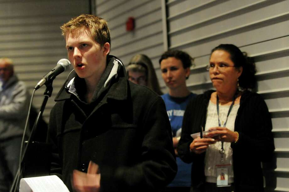 Brett McMullin, 18, a graduate of Capital Region BOCES, left, makes his comments during a forum on the Common Core curriculum on Thursday, Oct. 24, 2013, at Myers Middle School in Albany, N.Y. (Cindy Schultz / Times Union) Photo: Cindy Schultz / 00024364A