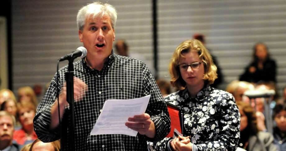 William Farmer, father of two boys in Burnt Hills-Ballston Lake schools, left, makes his comments during a forum on the Common Core curriculum on Thursday, Oct. 24, 2013, at Myers Middle School in Albany, N.Y. (Cindy Schultz / Times Union) Photo: Cindy Schultz / 00024364A