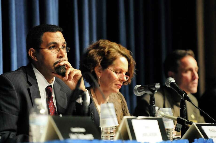 State Education Commissioner John B. King Jr., left, Assemblywoman Patricia Fahey, center, and Assemblyman Peter Lopez listen to comments during a forum on the Common Core curriculum on Thursday, Oct. 24, 2013, at Myers Middle School in Albany, N.Y. (Cindy Schultz / Times Union) Photo: Cindy Schultz / 00024364A
