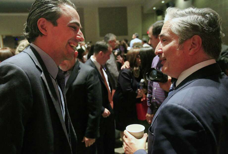 State Rep. Terry Canales (left) talks with University of Texas System Chancellor Francisco Cigarroa during the town hall meeting at UTPA in Edinburg. Photo: Gabe Hernandez / Monitor