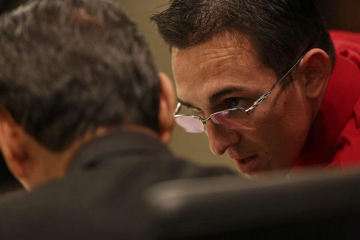 Griego talks with attorney Robert A. Valdez.