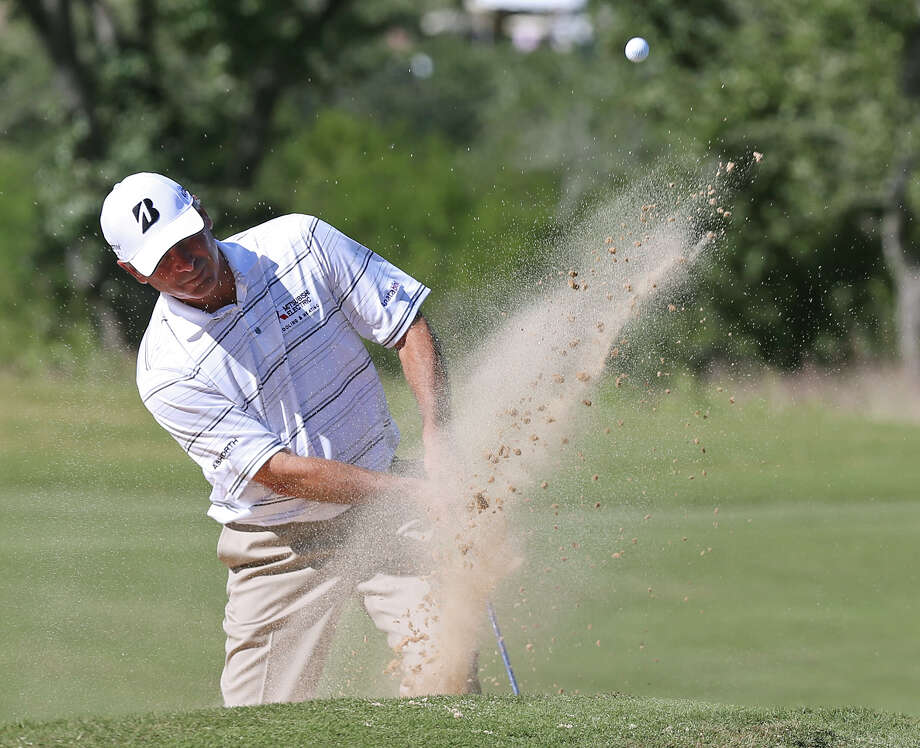 Fred Couples blast out of a 14th fairway bunker during the AT&T Championship Pro-Am at the Canyons Course of TPC San Antonio, Thursday, Oct. 24, 2013. Photo: Jerry Lara, San Antonio Express-News / ©2013 San Antonio Express-News