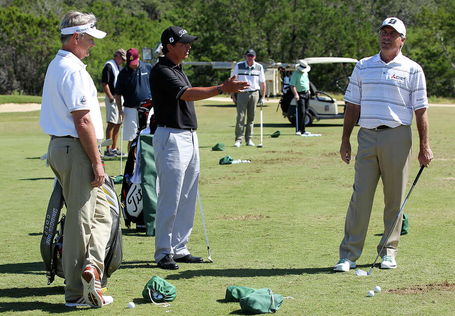 From left, John Cook, Tom Pernice, Jr, and Fred Couples converse while on the driving range before  the AT&T Championship Pro-Am at the Canyons Course of TPC San Antonio, Thursday, Oct. 24, 2013. Photo: Jerry Lara, San Antonio Express-News / ©2013 San Antonio Express-News