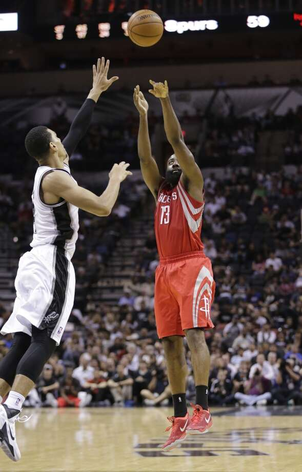 Rockets 109, Spurs 92 James Harden (13) shoots for three-points over Danny Green. Photo: Eric Gay, Associated Press