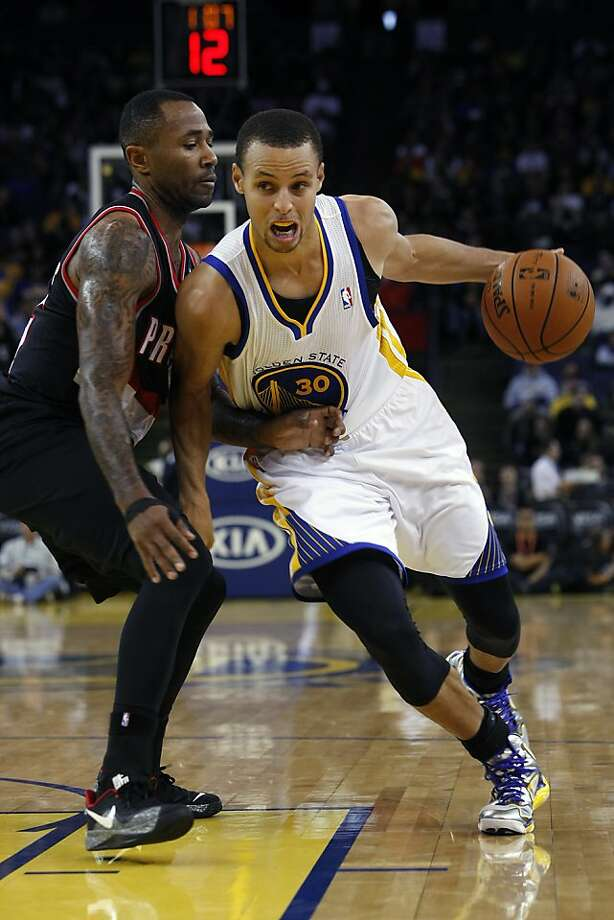 Stephen Curry drives on Mo Williams en route to 17 points in the Warriors' exhibition loss to Portland. The Warriors finished the exhibition season with two straight losses to fall to 3-4. Photo: Michael Short, The Chronicle