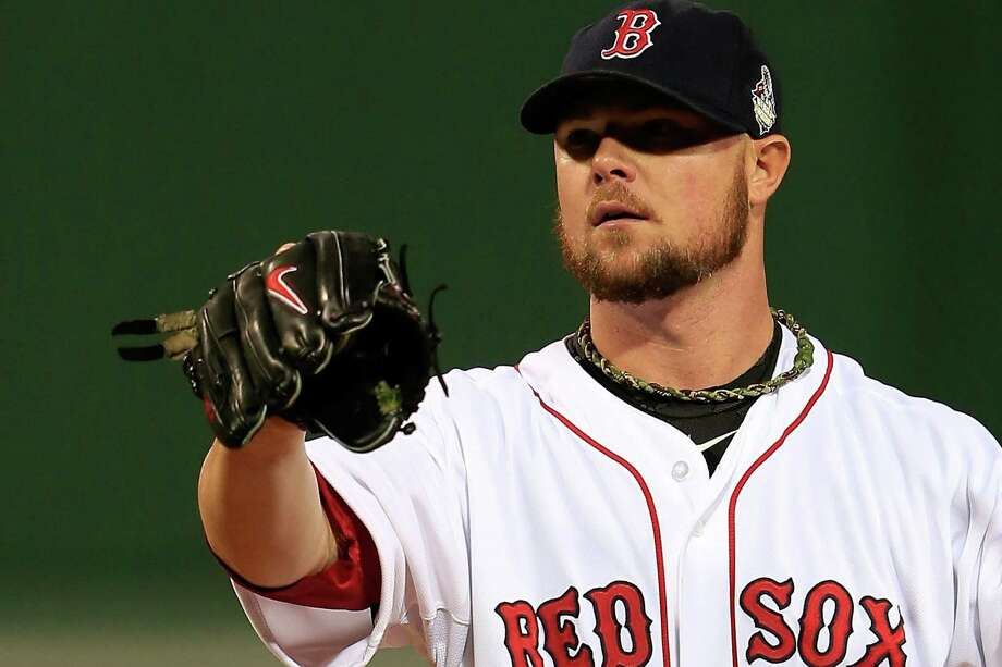 Red Sox pitcher Jon Lester said he had nothing but rosin — which is legal — inside his glove in Game 1. Photo: Jamie Squire / Getty Images