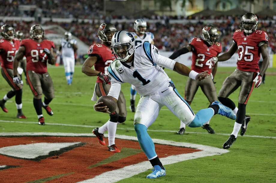 Quarterback Cam Newton (1) was right at home in Tampa Bay's end zone, playing a role in three of Carolina's four touchdowns on Thursday night. Photo: Chris O'Meara, STF / AP
