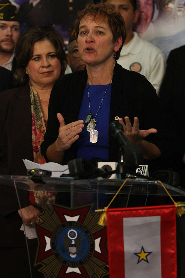 Donna Engeman, whose husband was killed in Iraq, speaks in favor of Proposition 1, which would benefit the spouses of troops killed in action. State Sen. Leticia Van de Putte stands next to Engeman. Photo: John Davenport /