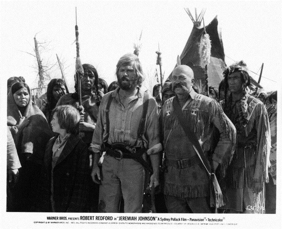 Josh Albee and Robert Redford standing with tribe of Indians in a scene from the film 'Jeremiah Johnson', 1972. (Photo by Warner Brothers/Getty Images) Photo: Michael Ochs Archives, Getty Images / 2012 Getty Images
