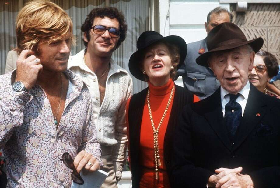 US actor Robert Redford (L), US director Sydney Pollack (2nd L), pianist Arthur Rubinstein (R) and his wife Nela pose during The Cannes International Film Festival, 08 May 1972. (Photo credit should read STAFF/AFP/Getty Images) Photo: STAFF, AFP/Getty Images / 2011 AFP