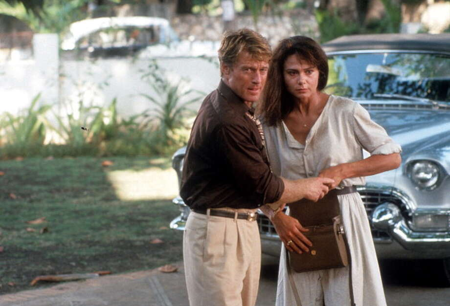Robert Redford holds the hand of Lena Olin in a scene from the film 'Havana', 1990. (Photo by Universal/Getty Images) Photo: Archive Photos, Getty Images / 2012 Getty Images