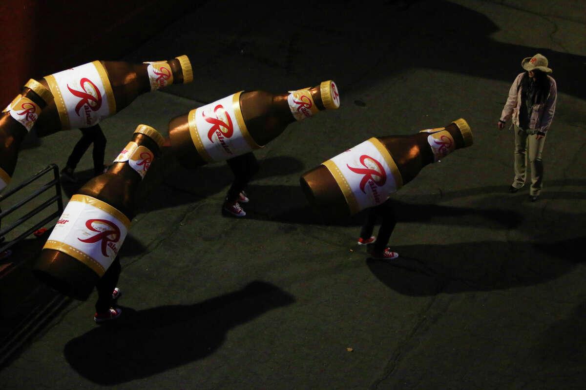 Rainier Beers walk to the celebration Friday as the Rainier