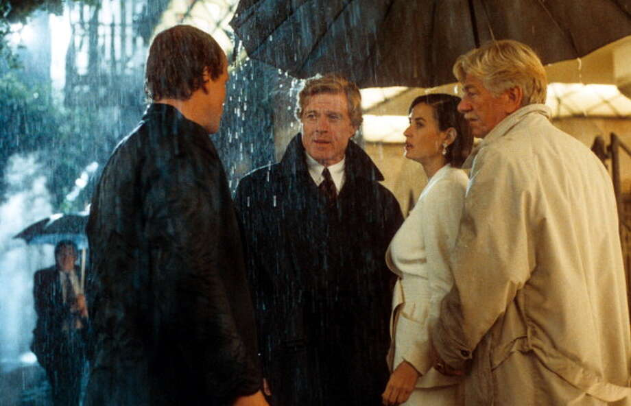 Robert Redford and Demi Moore standing under an umbrella in the pouring rain in a scene from the film 'Indecent Proposal', 1993. (Photo by Paramount Pictures/Getty Images) Photo: Paramount Pictures, Getty Images / 2013 Getty Images