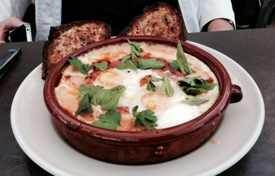 Eggs baked with polenta and tomato sauce at Bar Agricole ($15)