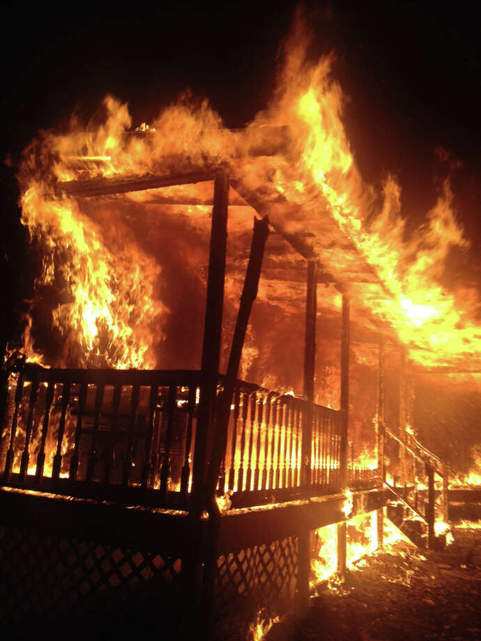 An early-morning blaze ripped through a home at 81 Bird Lane in Milford, Conn on Friday, Oct. 25, 2013. All three occupants escaped safely. Photo: Contributed Photo / Connecticut Post Contributed