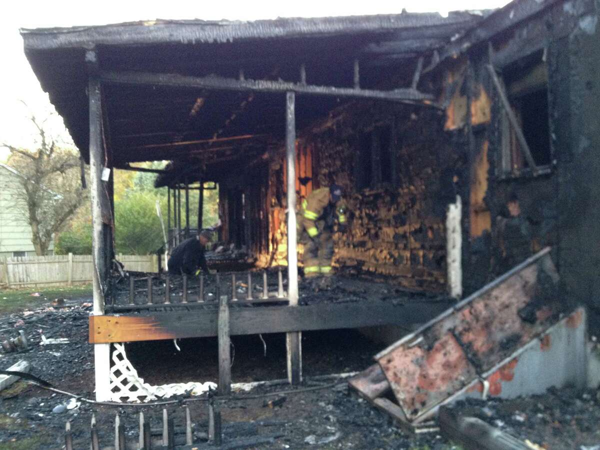 An early-morning blaze ripped through a home at 81 Bird Lane in Milford, Conn on Friday, Oct. 25, 2013. All three occupants escaped safely.