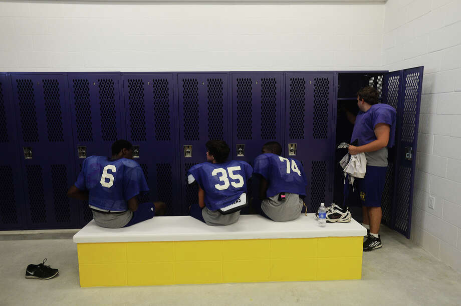 Sabine Pass football players inspect their new lockers following Wednesdays practice in preparation for Fridays homecoming game.  Michael Rivera/The Enterprise