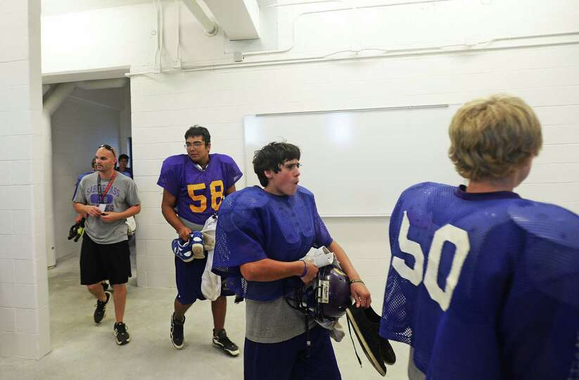 Sabine Pass varsity football players walk into their newly constructed locker rooms Wednesday. Micha